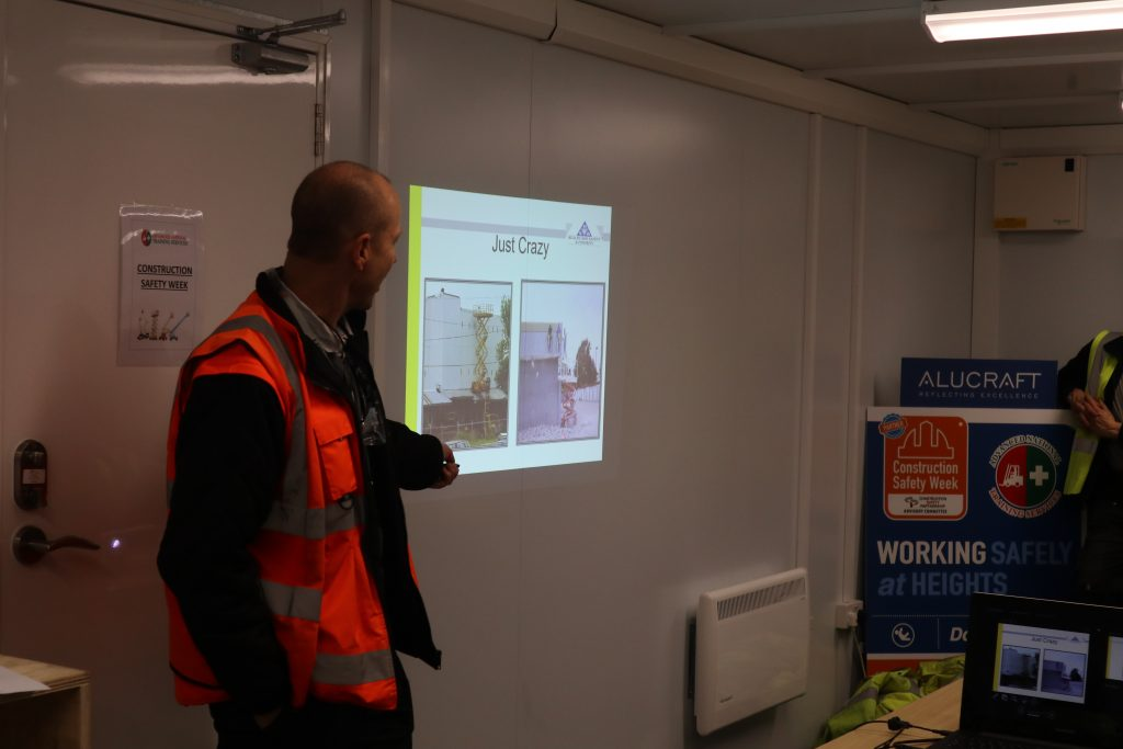 Safety instructor giving presentation to construction staff